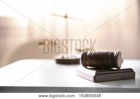 Judges gavel and justice scales on table in the room