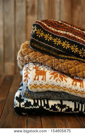 Stack of cozy knitted sweaters