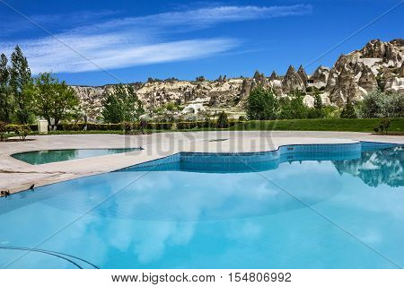 Goreme, Turkey - May 2, 2016: Open air swimming pool, Goreme, Cappadocia, Turkey