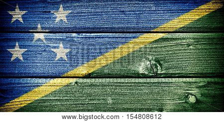 Flag of Solomon Islands painted on old grungy wooden background: 3d illustration