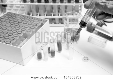 Black And White Micro Tubes In Laboratory, Blood, Urine In Freezer, Specimen Bank And Lab Sopplies O