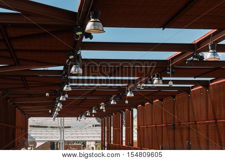 Industrial Pavilion: Wooden Roof Structure With Lamps And Cams