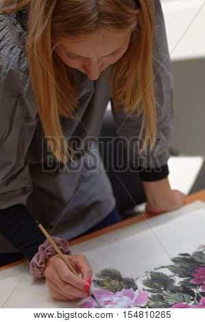 ST. PETERSBURG, RUSSIA - OCTOBER 20, 2016: Master class in Chinese painting Guohua during the China Day in Pulkovo airport. All created images was gifted to the public