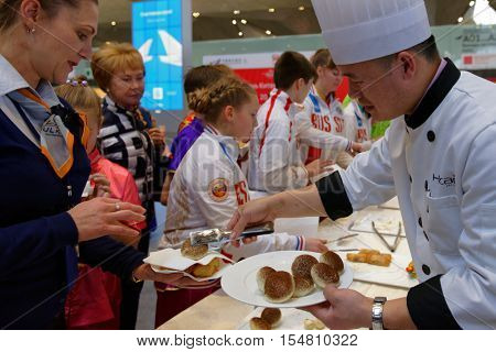 ST. PETERSBURG, RUSSIA - OCTOBER 20, 2016: Chef of restaurant Nihao presents the dishes of Chinese cuisine during the China Day in Pulkovo airport. Nihao offering the authentic Chinese dishes