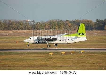 Borispol Ukraine - October 23 2011: Air Baltic Fokker 50 regional passenger plane is landing in the airport on sunset