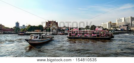 Bangkok, Thailand - December 8, 2015: Local transport boat and river taxi on Chao Phraya River in Bangkok Thailand.