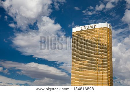Las Vegas USA - October 28 2016: Trump International Hotel in Las Vegas NV set against a dramatic blue sky. Named for US real estate developer and politician Donald Trump the 64-story luxury property's exterior windows are gilded with 24-carat gold.
