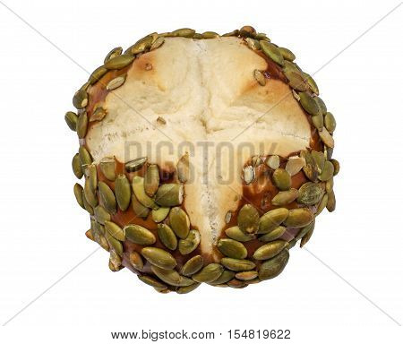 Freshly baked pretzel bun with seeds on a white background
