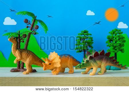 Dinosaur vegetarian on wild models background, dinosaur toy