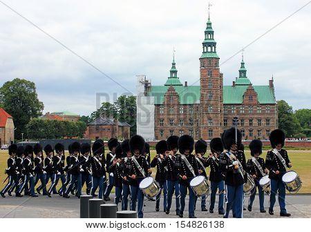 Copenhagen, Denmark - Aug 3, 2016: Royal guardsmen marching in field dress in Rosenborg slot, Denmark. Rosenborg is famous castle and museum of Copenhagen.