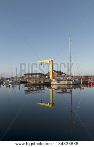 Reflections in the water in the small harbour Hou Denmark