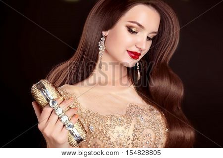 Beauty Makeup. Fashion Girl. Hairstyle. Beautiful Woman With Long Wavy Hair. Beauty Fashion Glamour