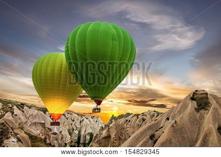 Hot air balloons green and yellow, Cappadocia, Turkey