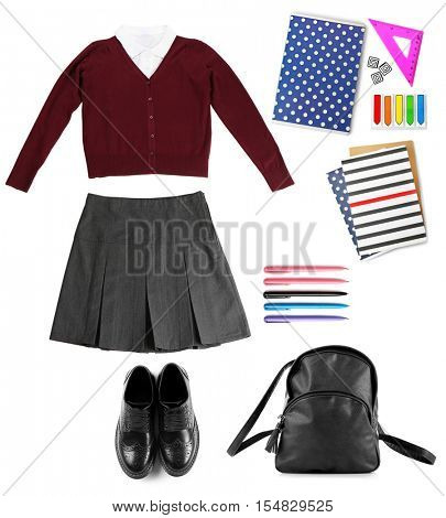 School female uniform with backpack on white background. Fashionable school set concept.
