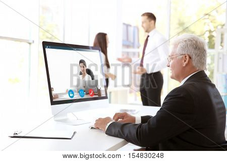 Man video conferencing with lawyer on computer. Video call and online service concept.