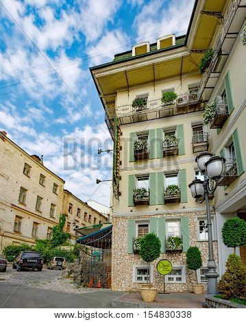 Kiev, Ukraine - September 11, 2016: Vozdvizhenka street at the Podil is a major tourist attraction of the city advertised by tour guides as the Montmartre of Kiev. Facade of the Hotel Vozdvyzhensky