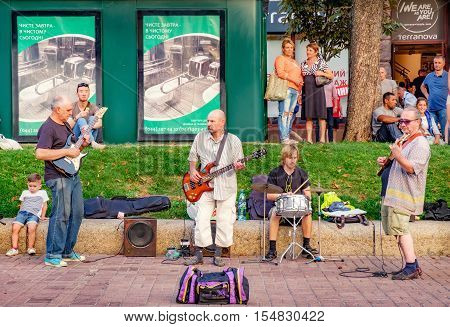 Kiev, Ukraine - September 11, 2016: Street musicians give a concert for tourists and citizens at the weekend on Khreschatyk Street