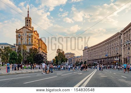 Kiev, Ukraine - September 11, 2016: Khreshatyk Street at weekend in Kiev. People walking through the street passing cafes restaurants and shops