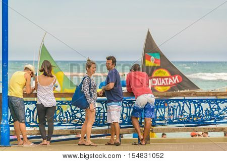 PORTO GALINHAS, BRAZIL, JANUARY - 2016 - People at boardwalk in a sunny day in Porto Galinhas a watering place located in Pernambuco Brazil
