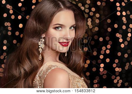 Makeup. Elegant Hairstyle. Beautiful Brunette Smiling With Long Wavy Hair, Red Lips Makeup And Fashi