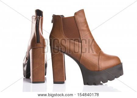 Brown autumn boots with chunky heels, isolated on white background