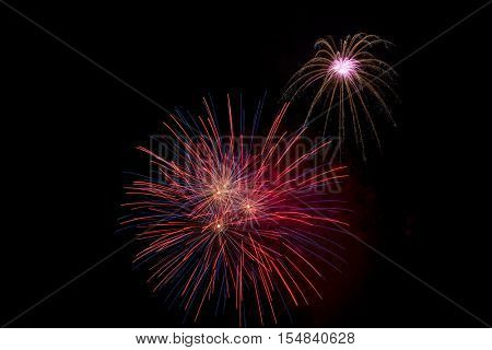 Colorful festive fireworks display making a background,  4th of July, New Years celebration