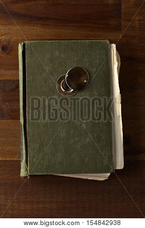 Old Book With Door Viewer On Wooden Table