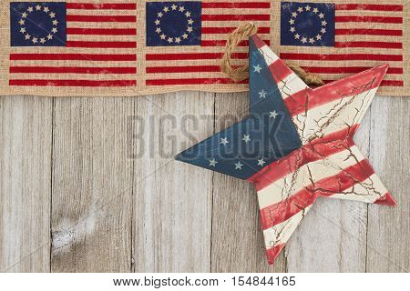 USA patriotic old flag and star with weathered wood background with copy space for your message