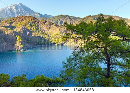 Turkish landscape with Olympos mountain, beach with green forest