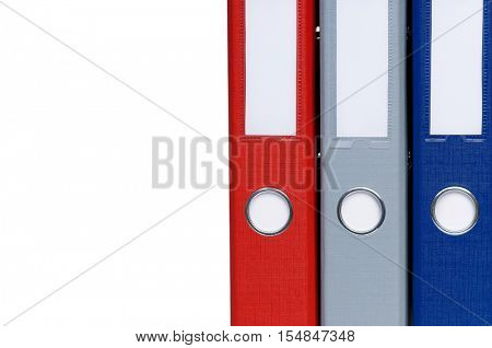 Close-up of colorful business file folders with office documents, isolated on white background