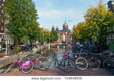 City view of Amsterdam with bridges and bicycles in the Netherlands