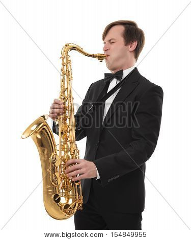 Saxophonist in a tuxedo plays music on sax on white background.