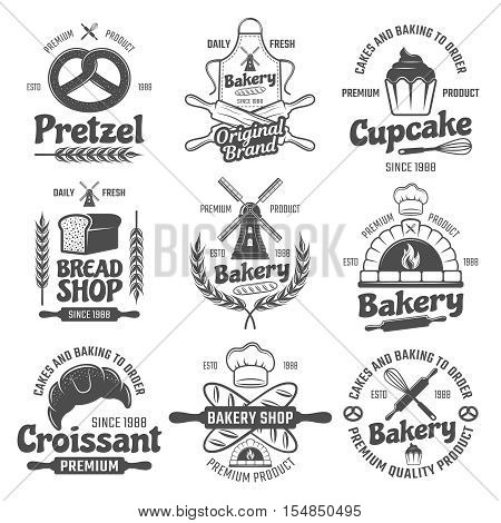 Bakery black white emblems with mill and wheat bread and pastry culinary tools isolated vector illustration