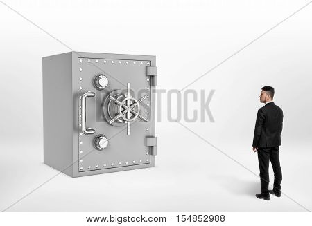 Full length illustration of businessman looking at the huge steel safe. Reliable protection. Peace of mind for your financial condition. Savings protection. Place to keep money. Keeping money.