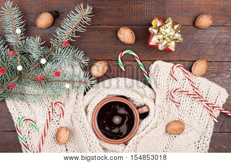 Christmas Background. Coffee Cup, Christmas Tree, Knitting Scarf, Present Gift Box, Walnuts And Cand