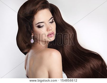 Long Hair. Beautiful Brunette Girl With Healthy Wavy Hair. Beauty Makeup, Sensual Lips. Attractive W