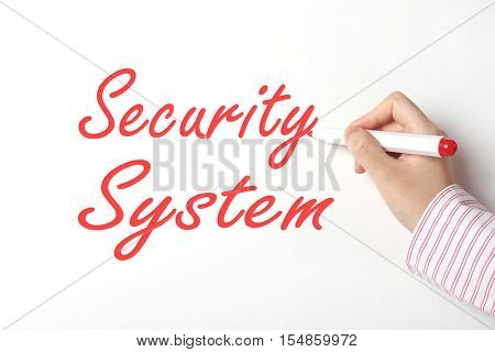 Business woman writing security system word on whiteboard