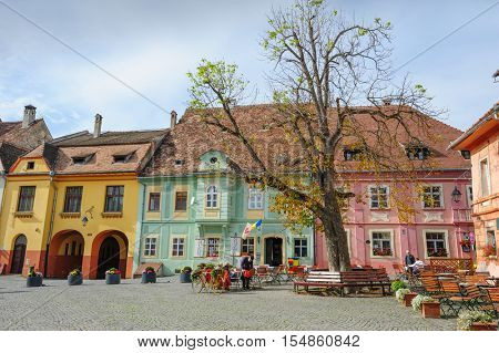 Sighisoara, Romania - October 19th, 2016: Famous view of central square in historic part of Sighisoara, Transylvania region, Romania