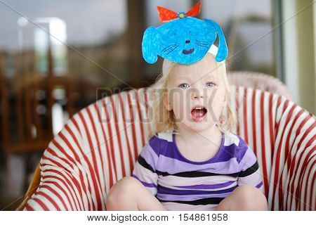 Cute Little Toddler Girl With A Self Made Puppy Mask