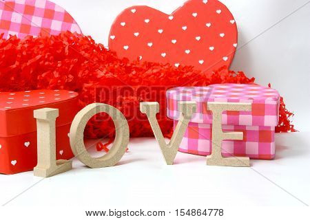 The concept of valentines day with letters of love and heart shaped gift boxes