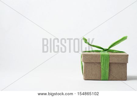 Simple Brown  Gift Box Tied With Green Raffia Ribbon
