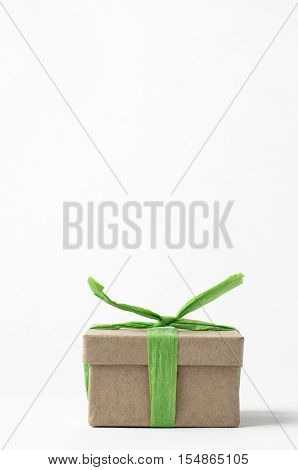 Simple Brown Gift Box Tied Up With Green Raffia Ribbon