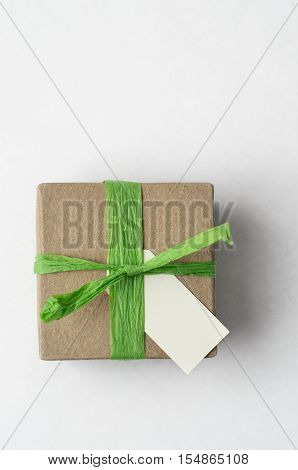 Simple Gift Box With Green Raffia Ribbon From Above