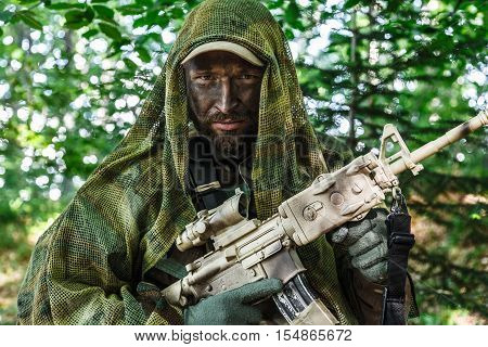 Member of Navy SEAL Team also known as Taliban hunter with weapons