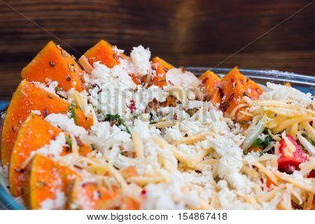 Vegan Dish Of Orange Pumkin, Vegetables, Herbs And Cheese