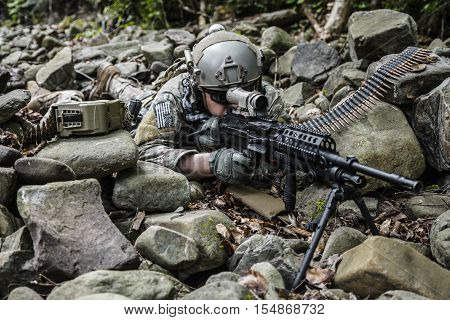 United states army ranger machine gunner in the forest