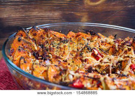 Vegetarian Dish Of Baked Pumkin, Vegetables, Herbs, Cheese