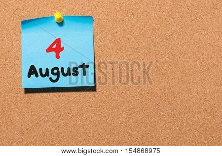 August 4th. Day 4 of month, color sticker calendar on notice board. Summer time. Empty space for text.