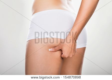 Close-up Of A Woman Pinching Excessive Fat Of Buttock