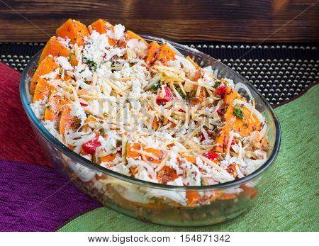 Vegetarian Dish Of Orange Pumkin, Vegetables, Herbs And Cheese